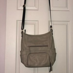 Grey crossbody multi pocket tote.